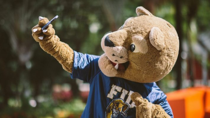 FIU Panther mascot Roary holding up cellphone taking a selfie