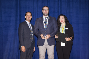(From left) FIU Online Assistant Vice President, Joseph Riquelme, Lukas K. Danner, PhD, and Instructional Designer Nina Crutchfield