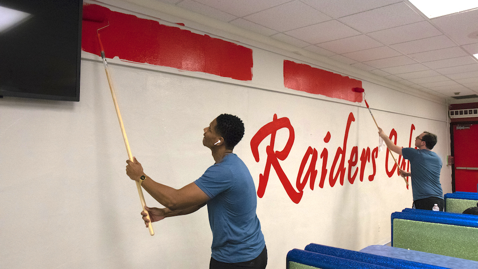 FIU Online members work with paint rollers.