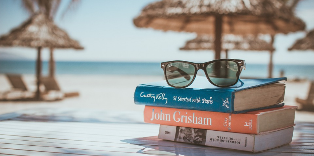 Books and sunglasses near the beach