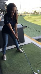 woman with a golf club