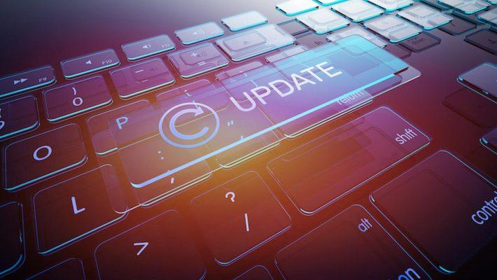Update Button on Computer Glass Keyboard