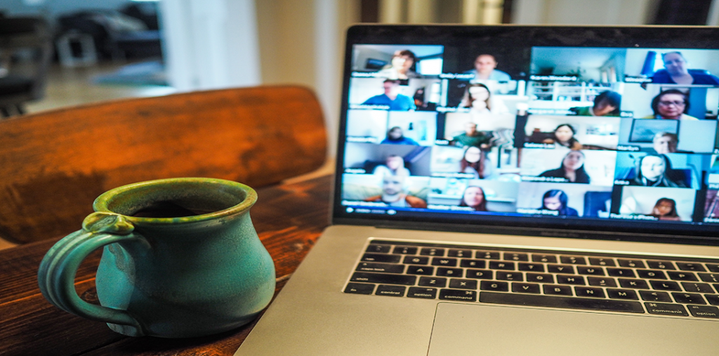 Coffee next to a laptop with Zoom open.