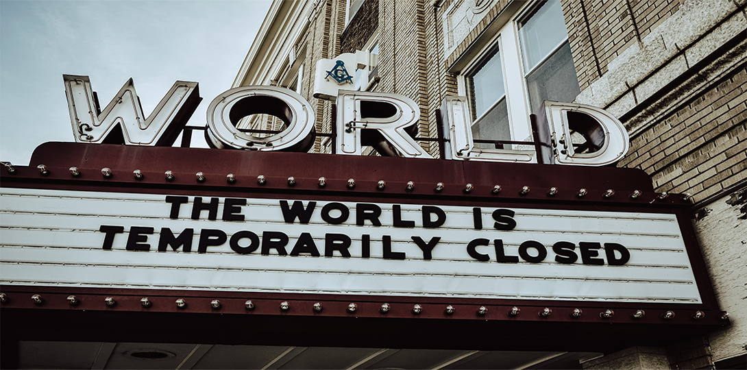 """Movie theater sign with the words, """"The World is Temporarily Closed."""""""
